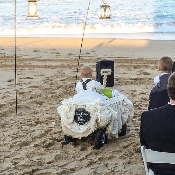 These kids are loving their chance to shine at a beach wedding on the outer banks at the sea ranch resort, the sea ranch resort invites everyone to an obx wedding at their venue,