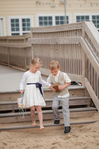 The kids are alright at a beach wedding in kill devil hills nc at the sea ranch resort, the sea ranch resort has a wedding venue that these children made more beautiful, the sea ranch resort hosting kids at a beach wedding on the obx