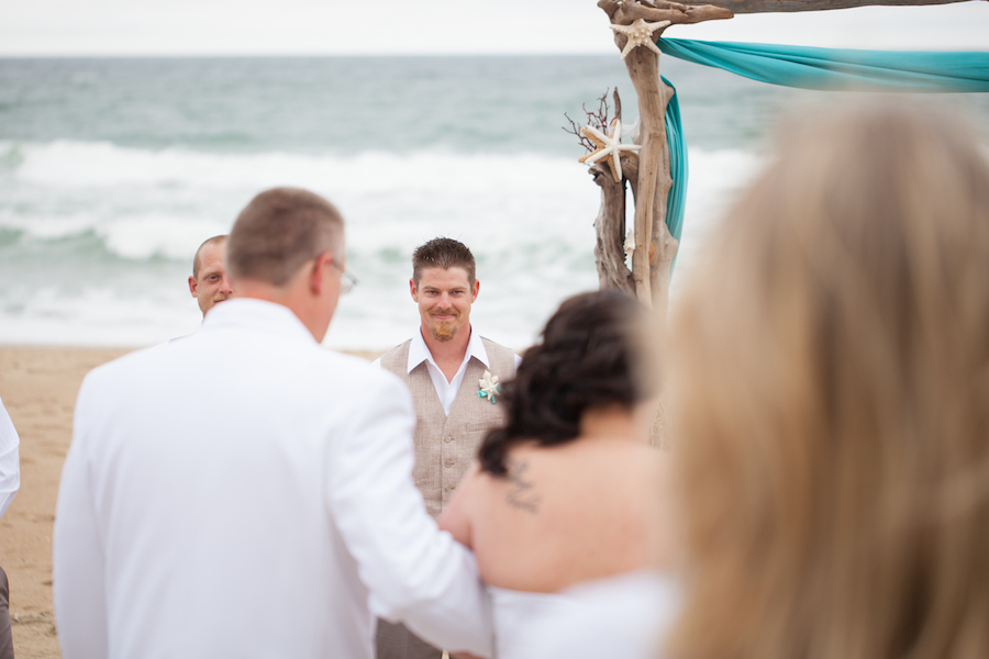 a perfect couple on a perfect beach getting married at the sea ranch resort, the sea ranch resort hosted this beautiful couple at their obx wedding venue , this couple will be happy forever because they had a beach wedding at the sea ranch resort