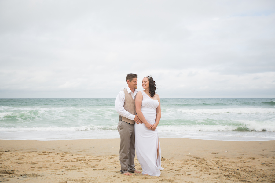 this couple looks amazing on the beach at their wedding on the obx at the sea ranch resort, a beach wedding is amazing at the sea ranch resort, the sea ranch resort has a wedding venue for the couple