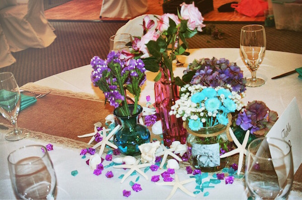 Flowers ignite the center of the table